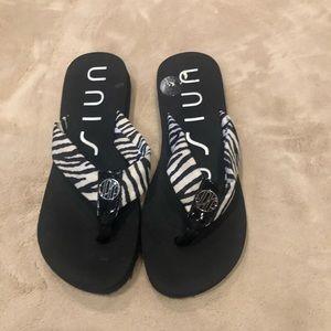 UNISA zebra patterned flip flops